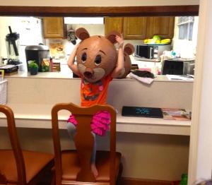 Goldilocks trying out a bear head